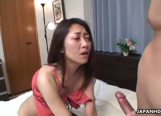 Skinny Asian doll nicely sucks in the bed
