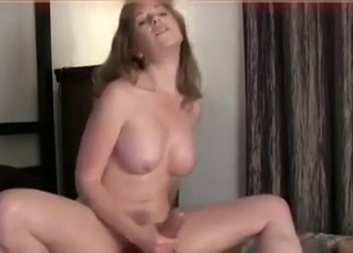 Busty beauty MILF jerks off his hard boner