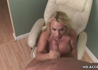 Skillful blonde stimulates his huge boner