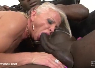 Two black bulls fuck with a slutty blonde