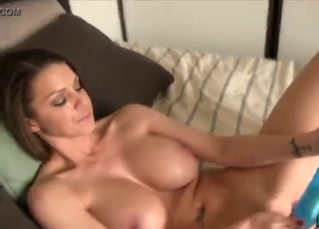 Busty angel is playing with a sex toy