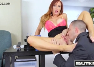 Awesome redhead fucked by her boss