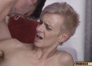 Slutty mature takes a very big young cock