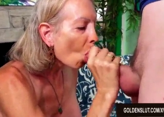 Great-looking GILF is sucking a young cock