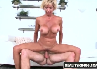Busty blonde mature takes a young boner